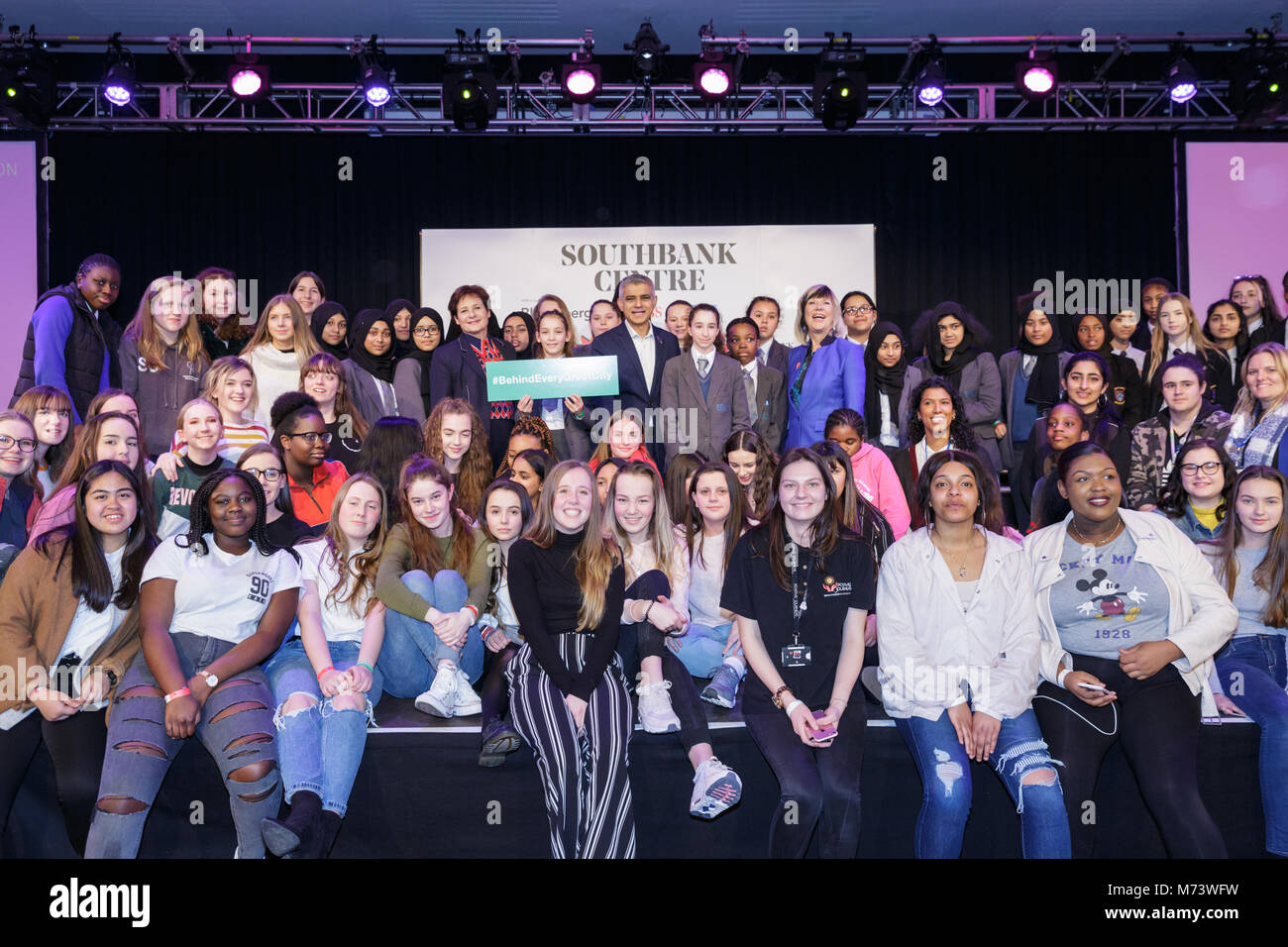 Royal Festival Hall, London, 8th March 2018. London Mayor Sadiq Khan is joined on stage by around 200 girls from - Stock Image