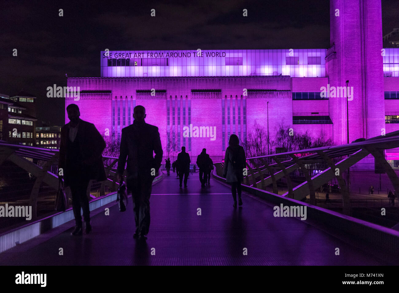 London, UK.  8 March 2018.  Tate Modern (pictured) and Tate Britain are lit up in a magenta colour to mark International Stock Photo