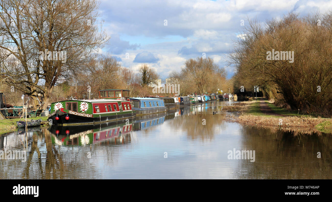 Kennet & Avon Canal in west Berkshire with moored Narrowboats on the riverbank - Stock Image
