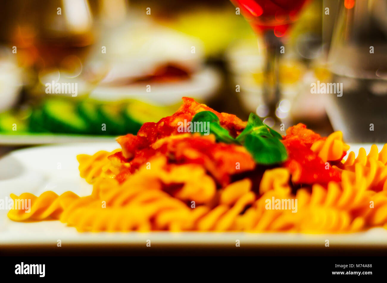 tasty dish with pasta, meat and sauce, Italian dish, fast and simple dish, lunch or dinner - Stock Image