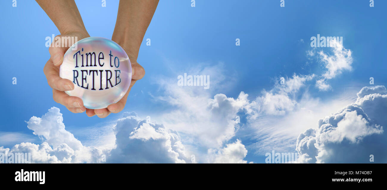 Looks like it is time to retire - Female hands holding a large crystal ball containing the words TIME TO RETIRE - Stock Image