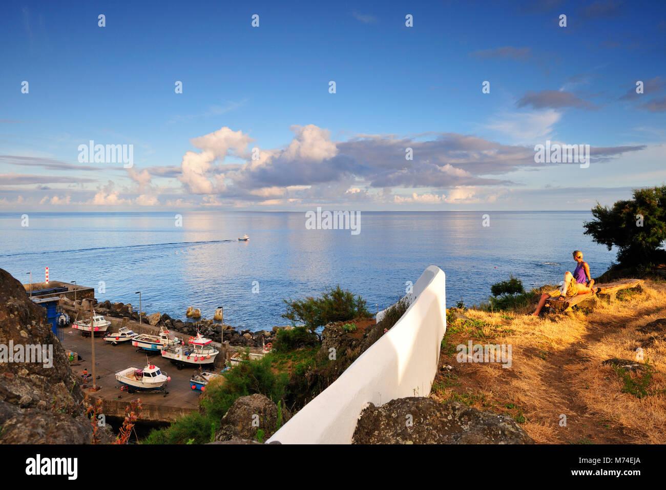 Contemplation of the sea. Vila Nova do Corvo at twilight. Corvo island. Azores, Portugal - Stock Image