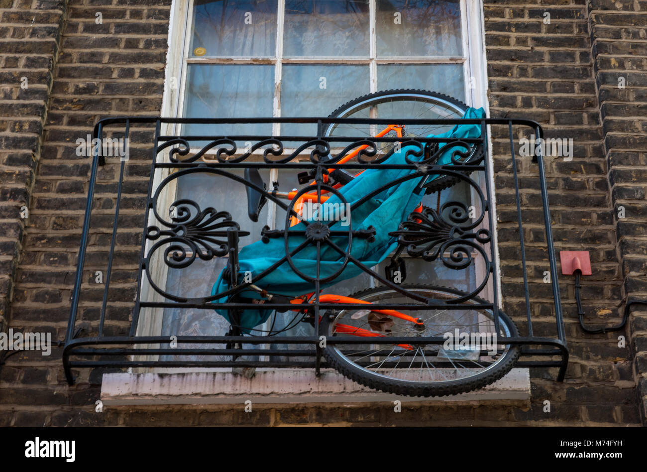 a novel, different and unusual innovative inventive way to store a cycle or bicycle rack in central london. Commuting - Stock Image