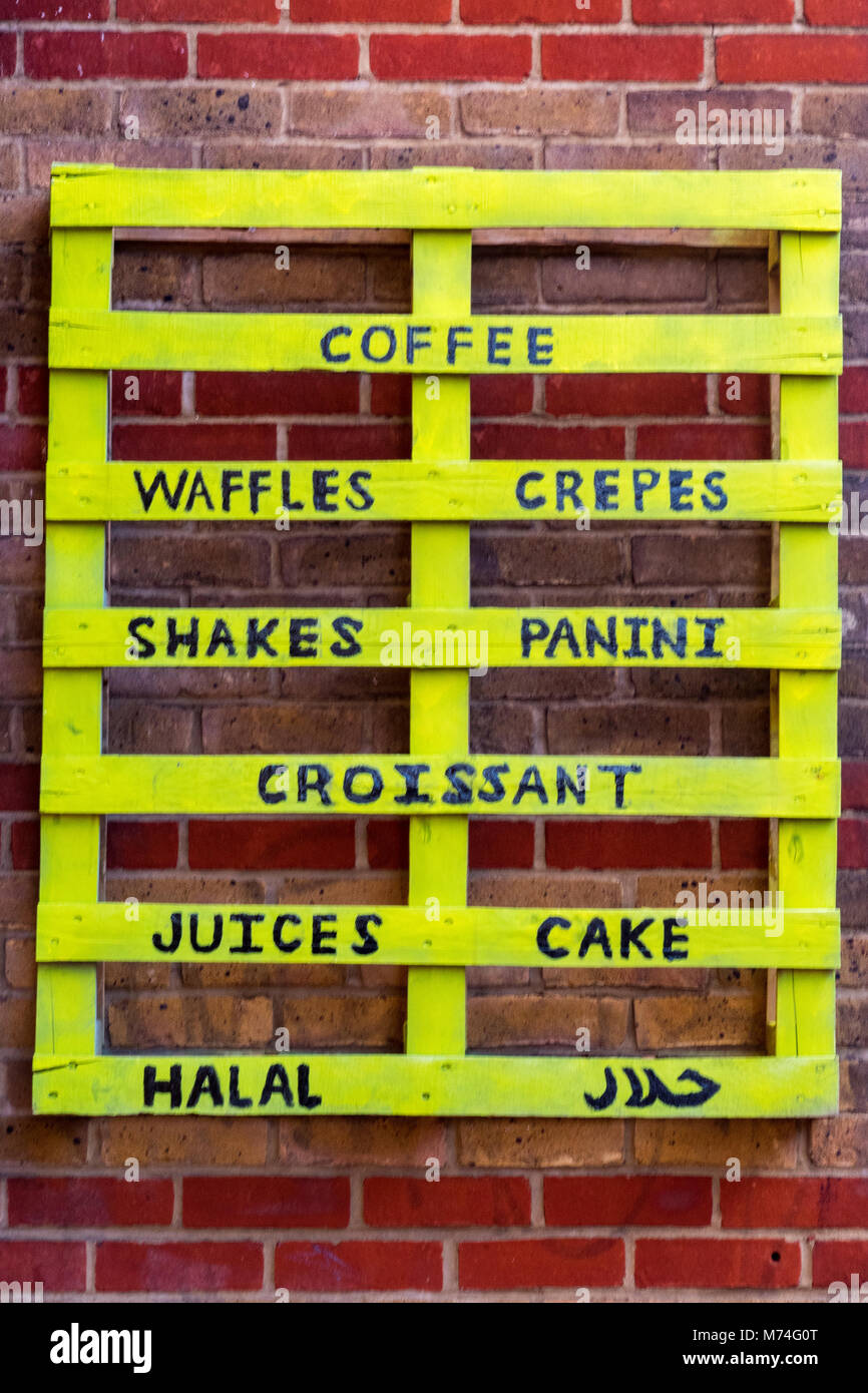 an unusual or different advertising board made from a forklift pallet upcycling to advertise a cafe menu in borough, - Stock Image