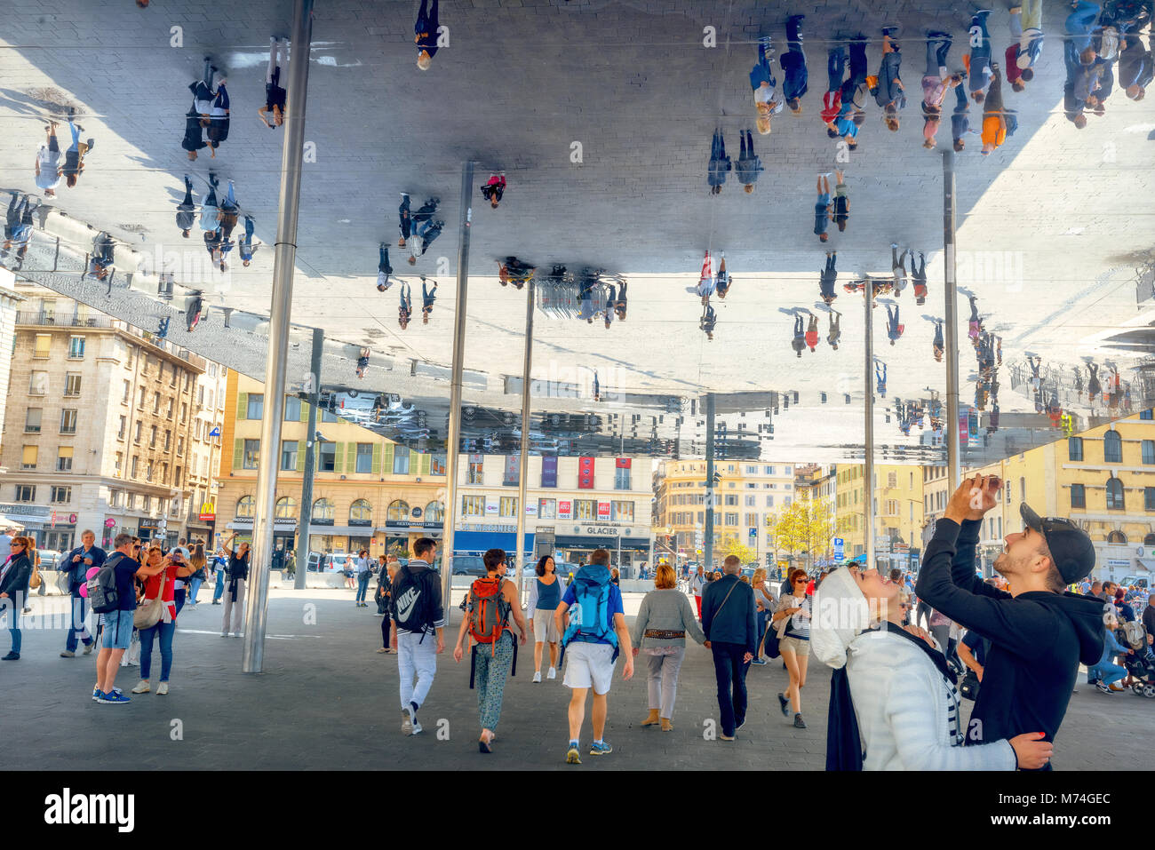 View of modern mirrored awning at Vieux Port with people walking and looking at their reflection. Marseille, France, - Stock Image