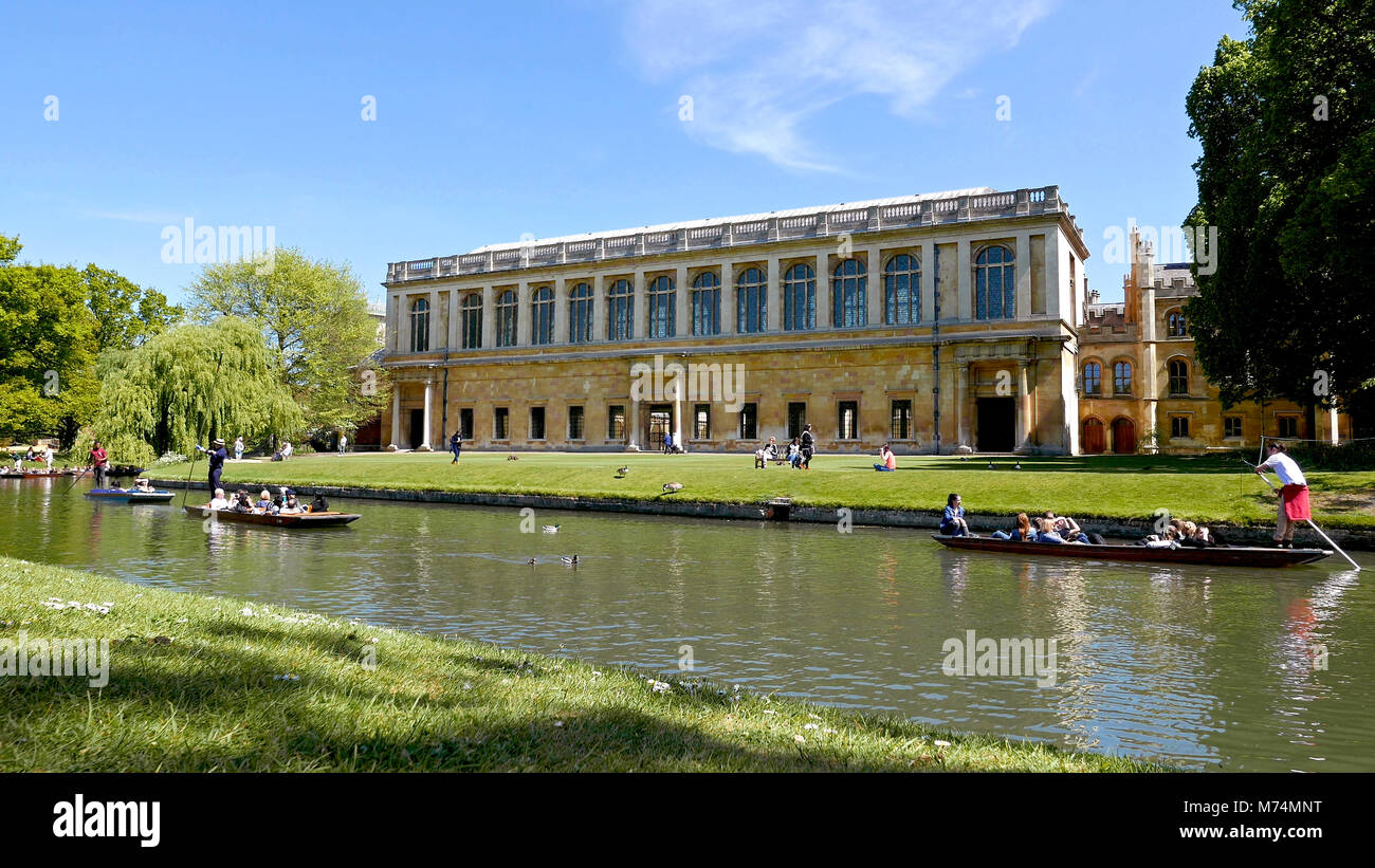 Trinity College Cambridge from far bank of River Cam with Students Punting and Ducks - Stock Image