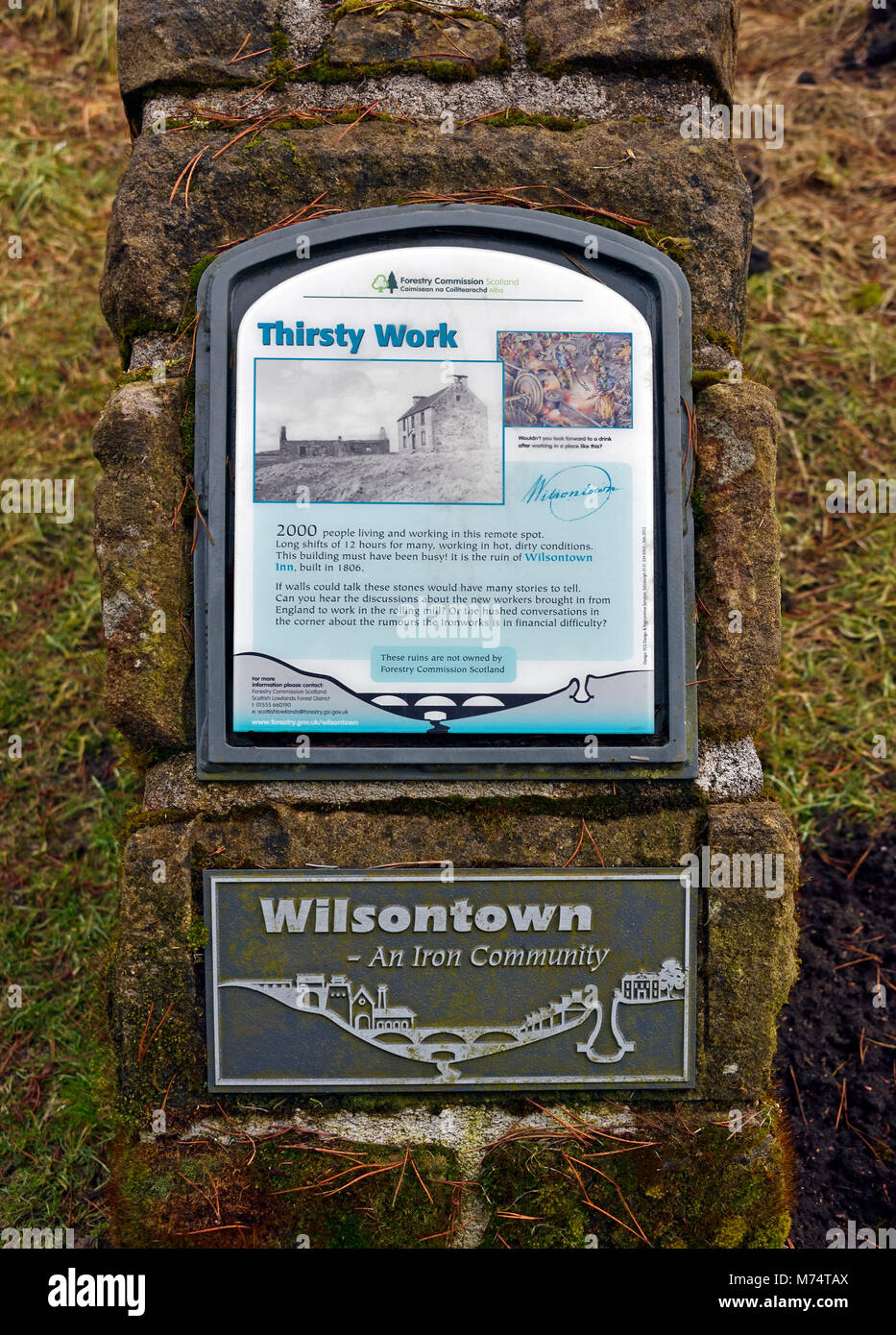 Descriptive signboard. 'Thirst work'. Site of the ruined Wilsontown Inn.  Wilsontown, Forth, Lanarkshire, - Stock Image