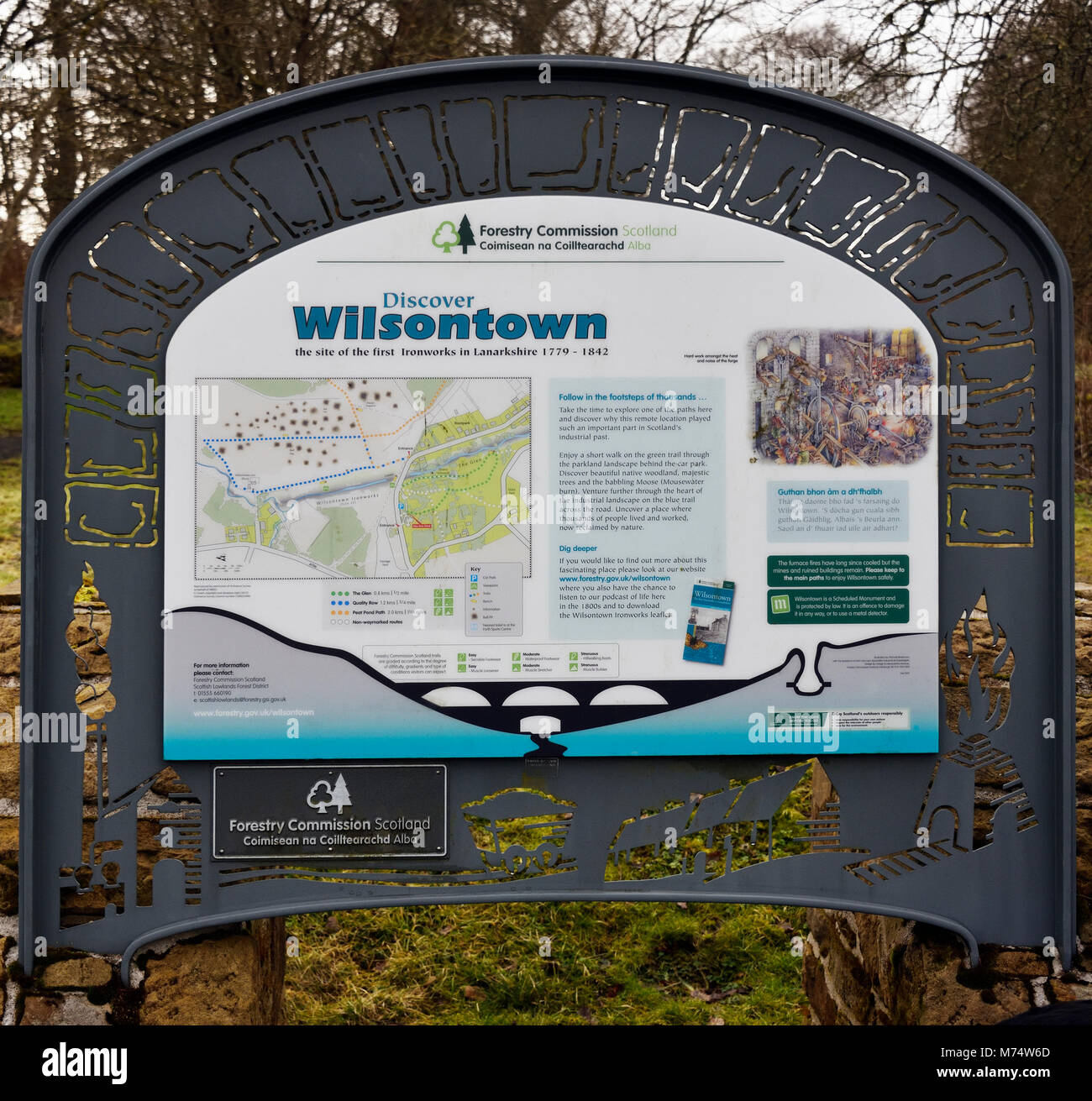 Descriptive signboard. 'Discover Wilsontown the site of the first Ironworks in Lanarkshire 1779 - 1842'. - Stock Image