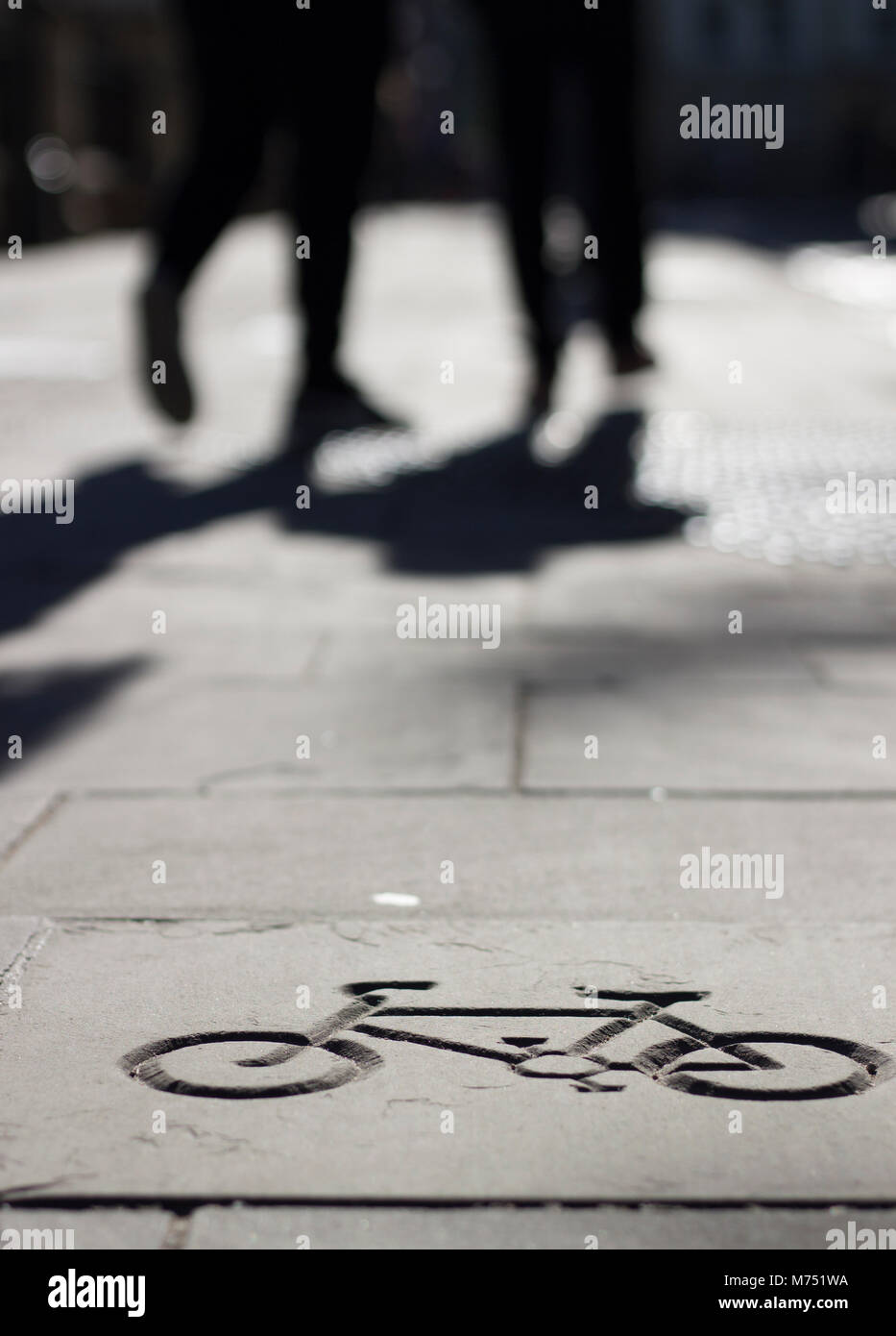 A marked cycleway with walking figures in silhouette in Bristol the home of Sustrans cycleway charity Stock Photo