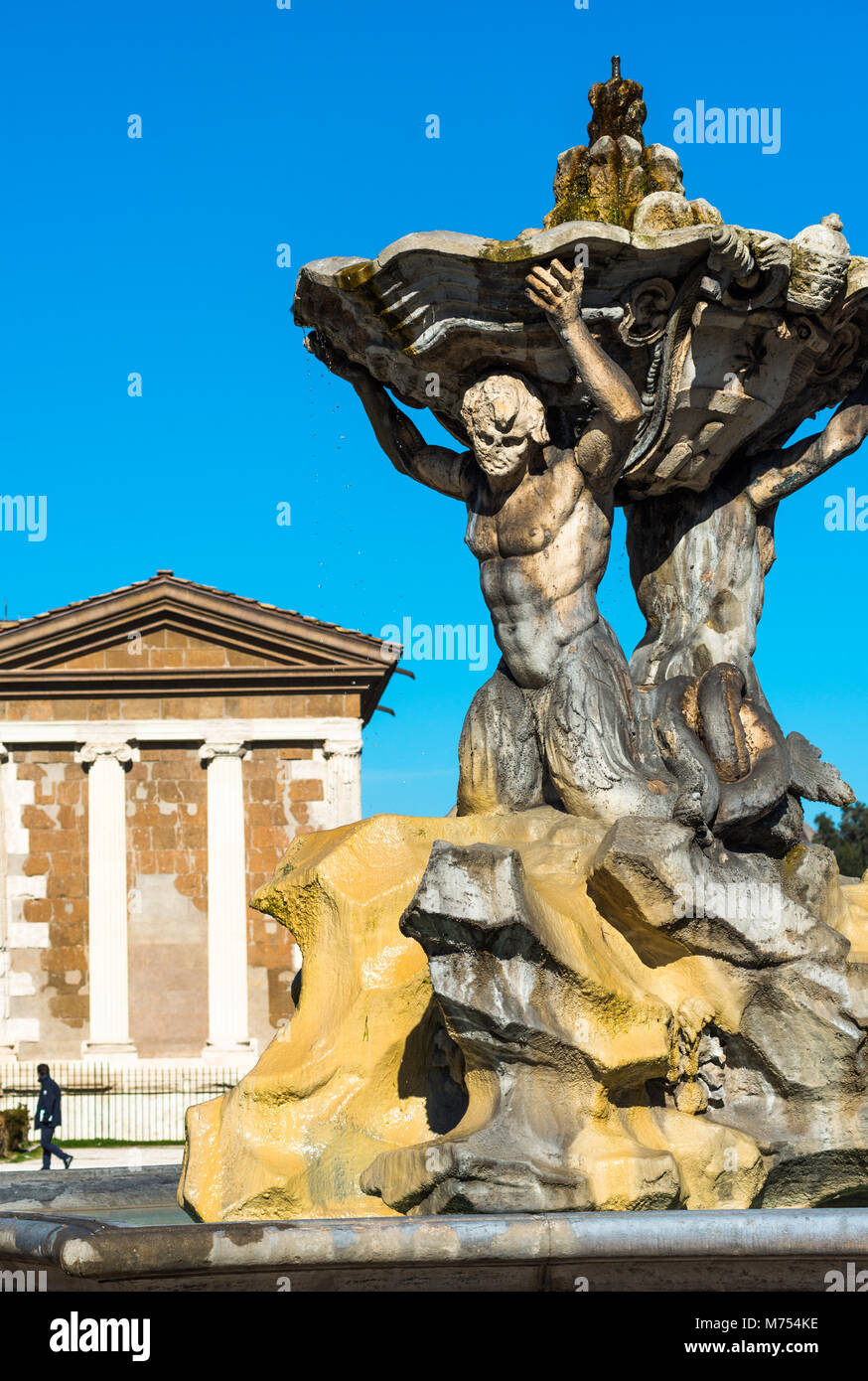 Triton's Fountain or Fontana dei Tritoni with Temple of Portunus (Temple of Fortuna Virilis) in Piazza della - Stock Image
