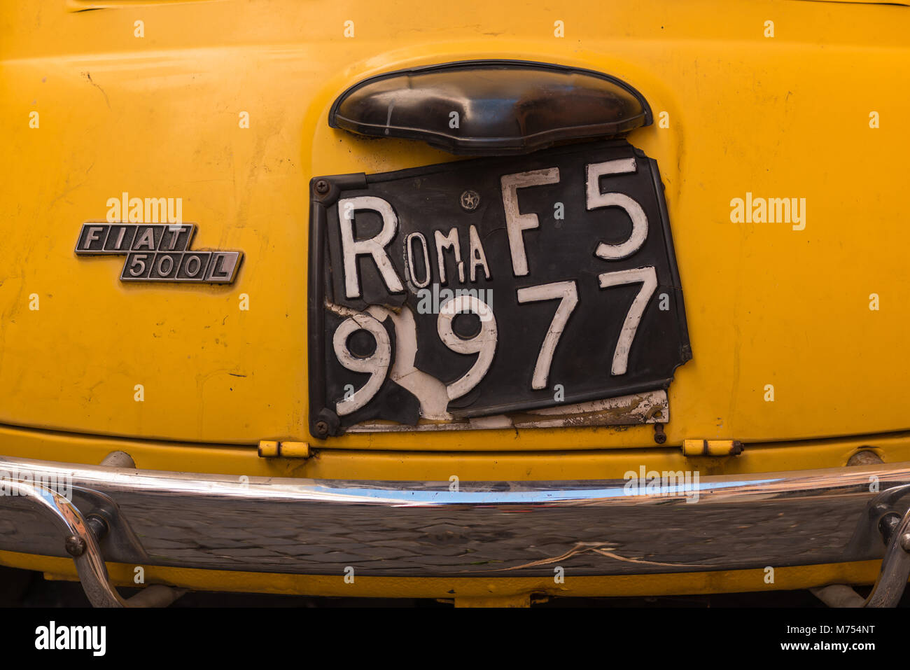 Classic Fiat 500 car with Roma plates, parked on Trastevere backstreet, Rome, Lazio, Italy. - Stock Image