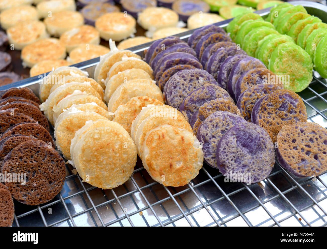 Babin candy is Thai style street coconut sweet pancake ,the old thai dessert in outdoor under umbrella lighting. - Stock Image