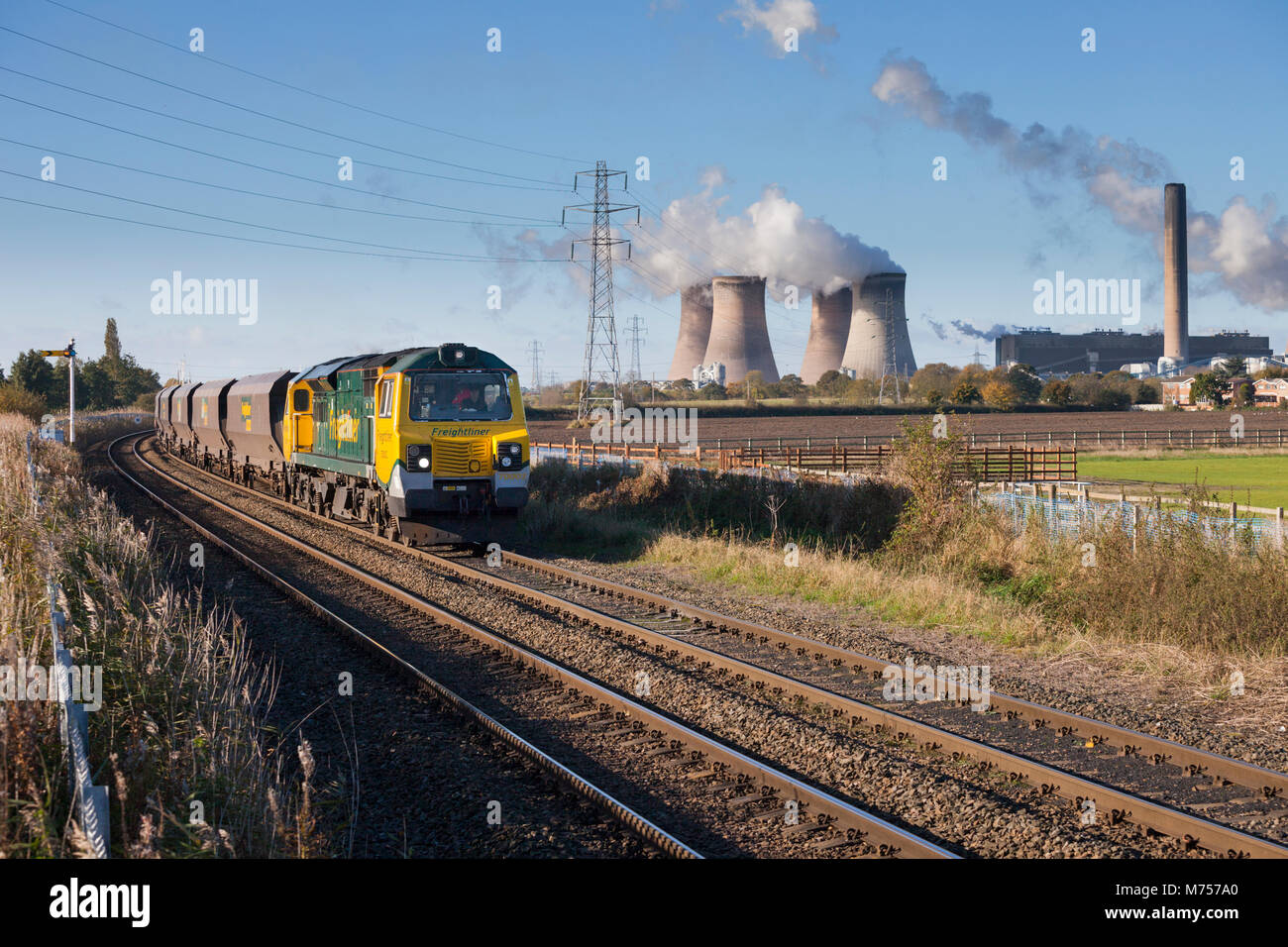 A Freightliner class 70 locomotive at  Penketh Hall with an empty merry go round coal train from  Fiddlers ferry Stock Photo