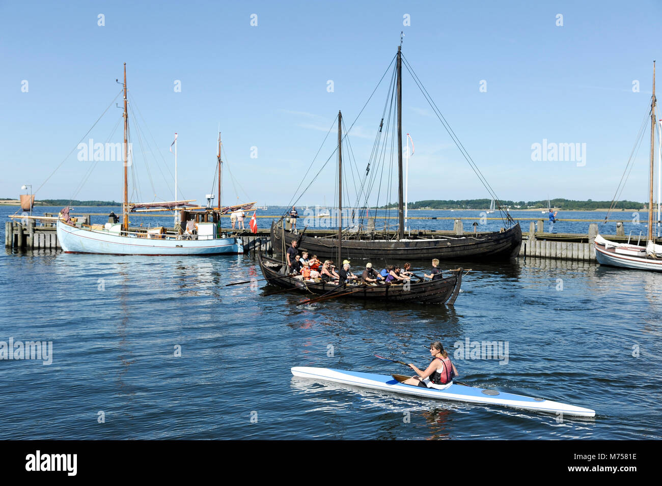Collection of authentic historic boats from Scandinavia and full scale navigable reconstructions of Viking ships - Stock Image