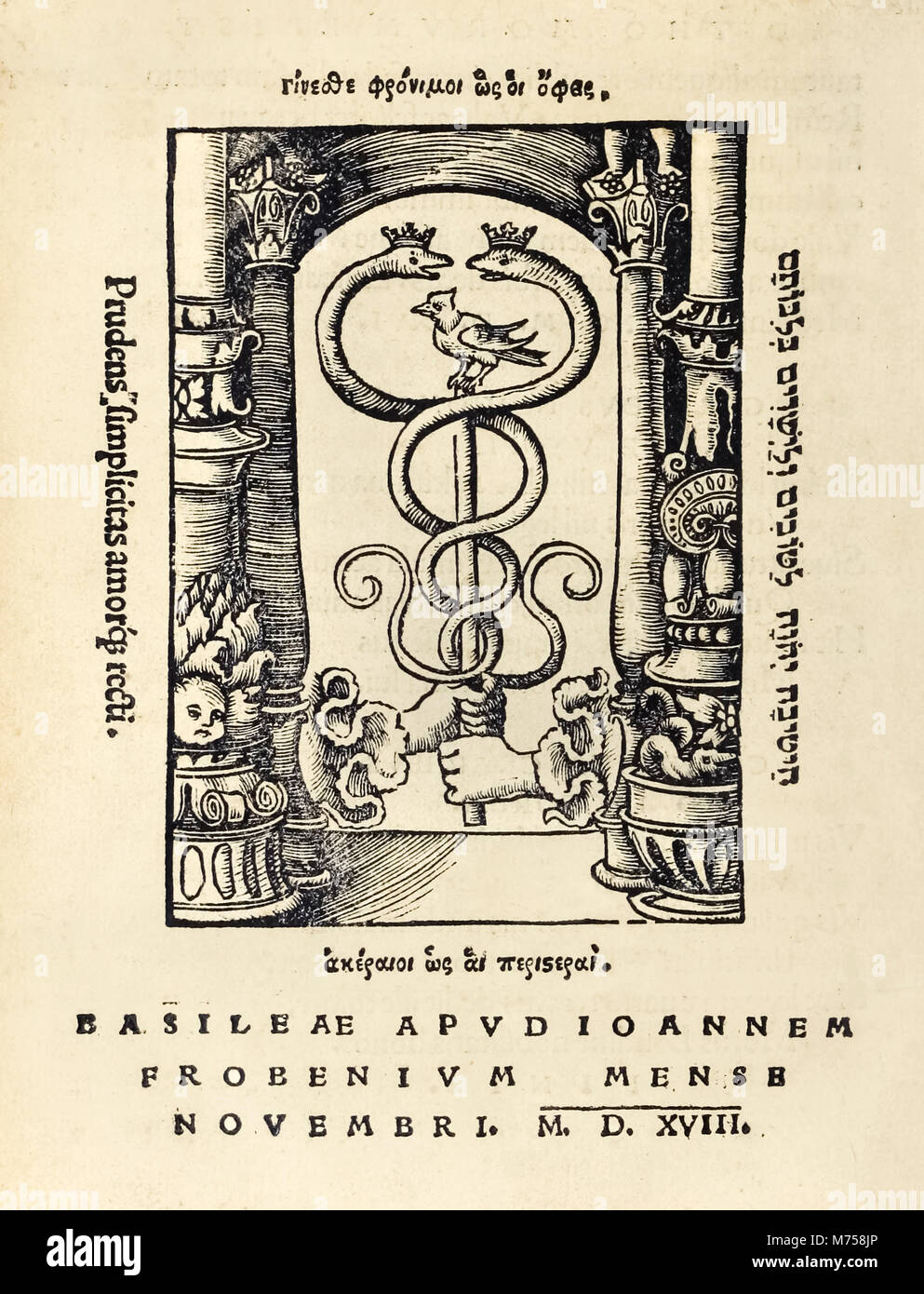 Printer's mark of Johann Frobens (c.1460 – 1527) showing two hands holding the caduceus from the 1518 third - Stock Image