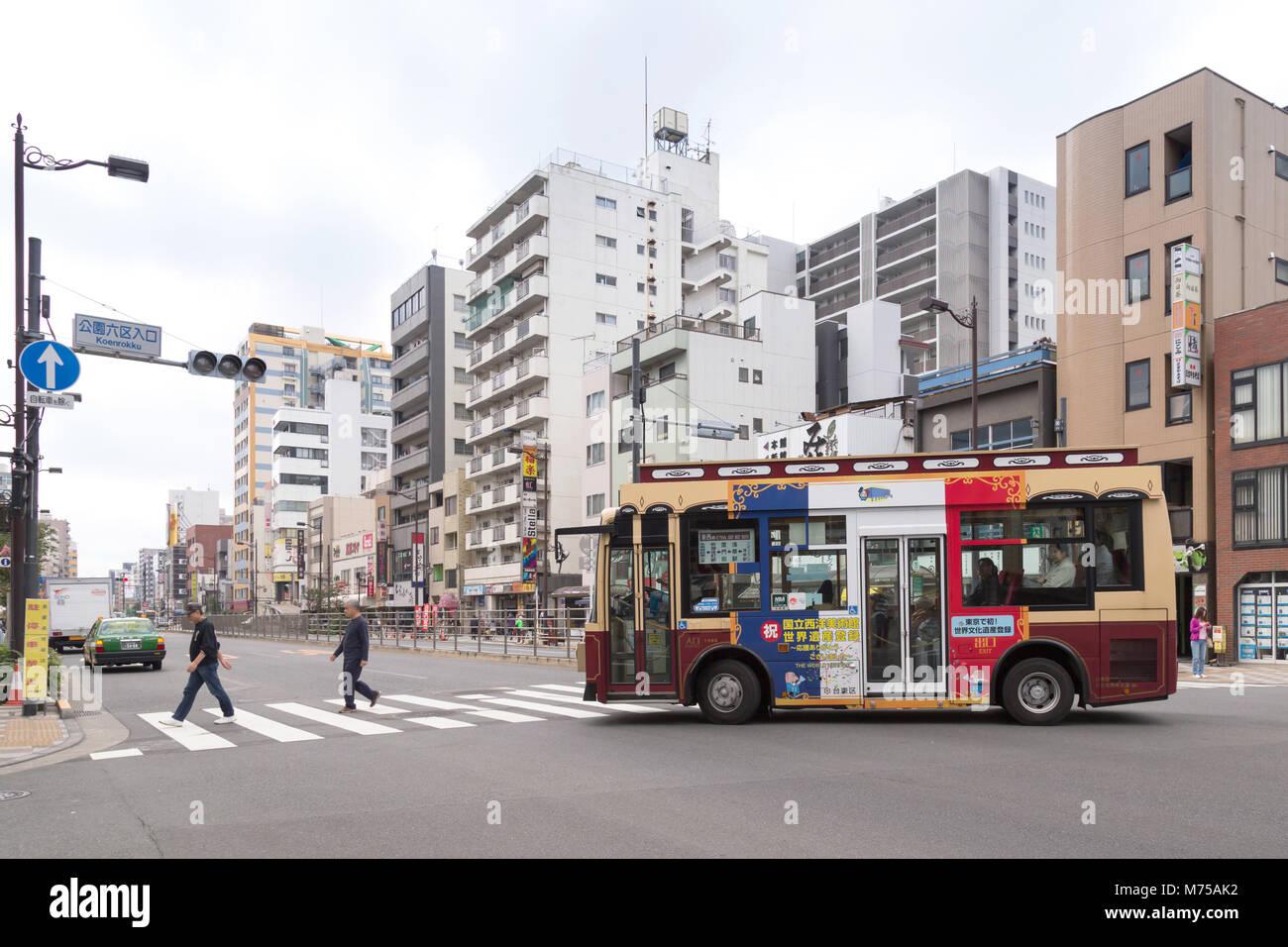 12e9f6d33 Tokyo, Japan - November 17, 2017 : Two Japanese men are crossing pedestrian  lane