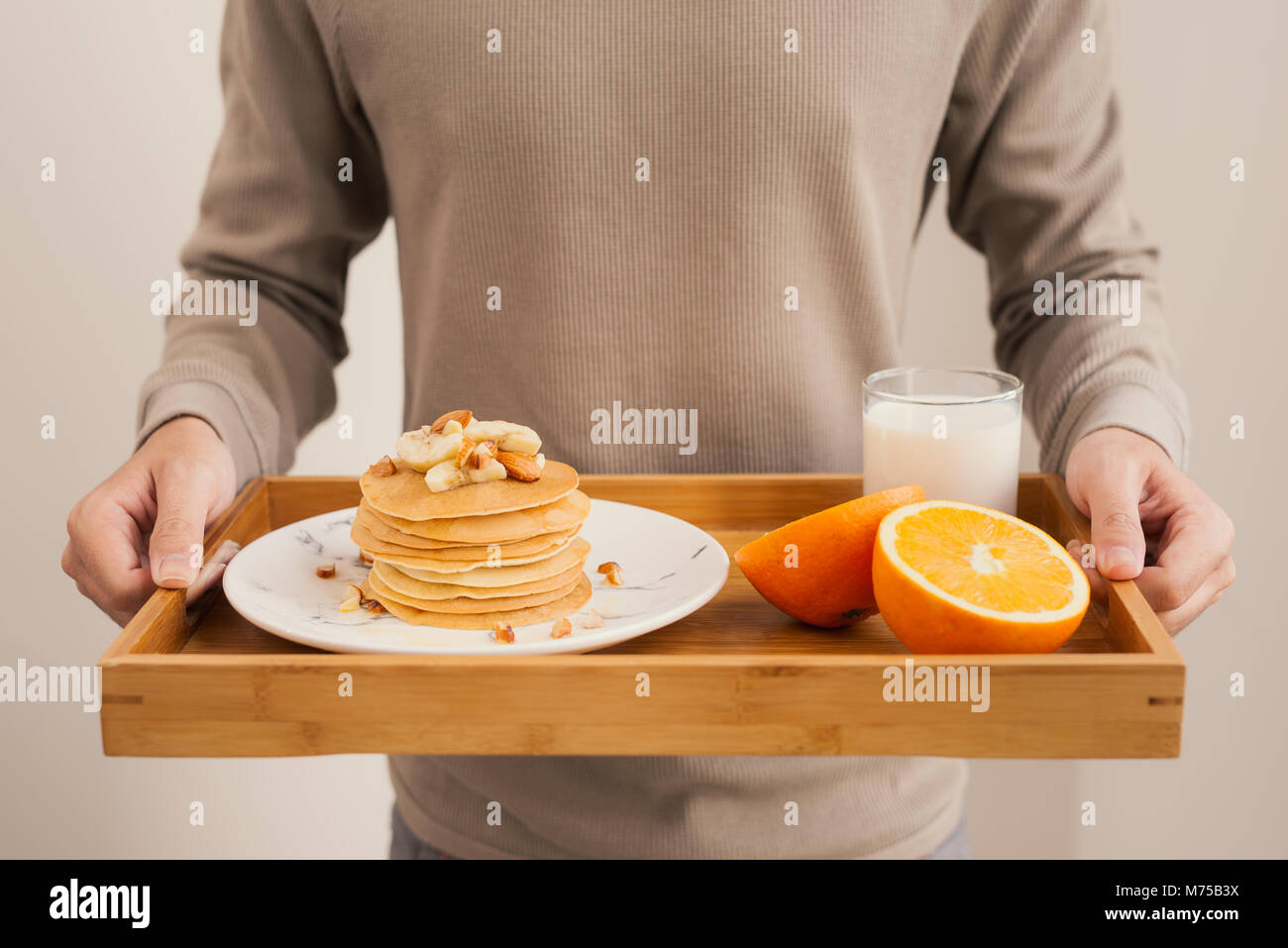 Serve breakfast. Banana pancakes with honey and nuts - Stock Image