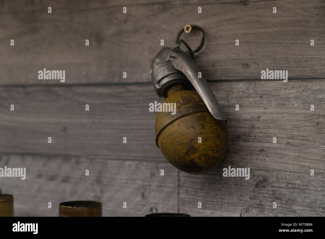 Old German Army,Third Reich military hand grenade on display at War Tunnells,Jersey,Channel Islands - Stock Image