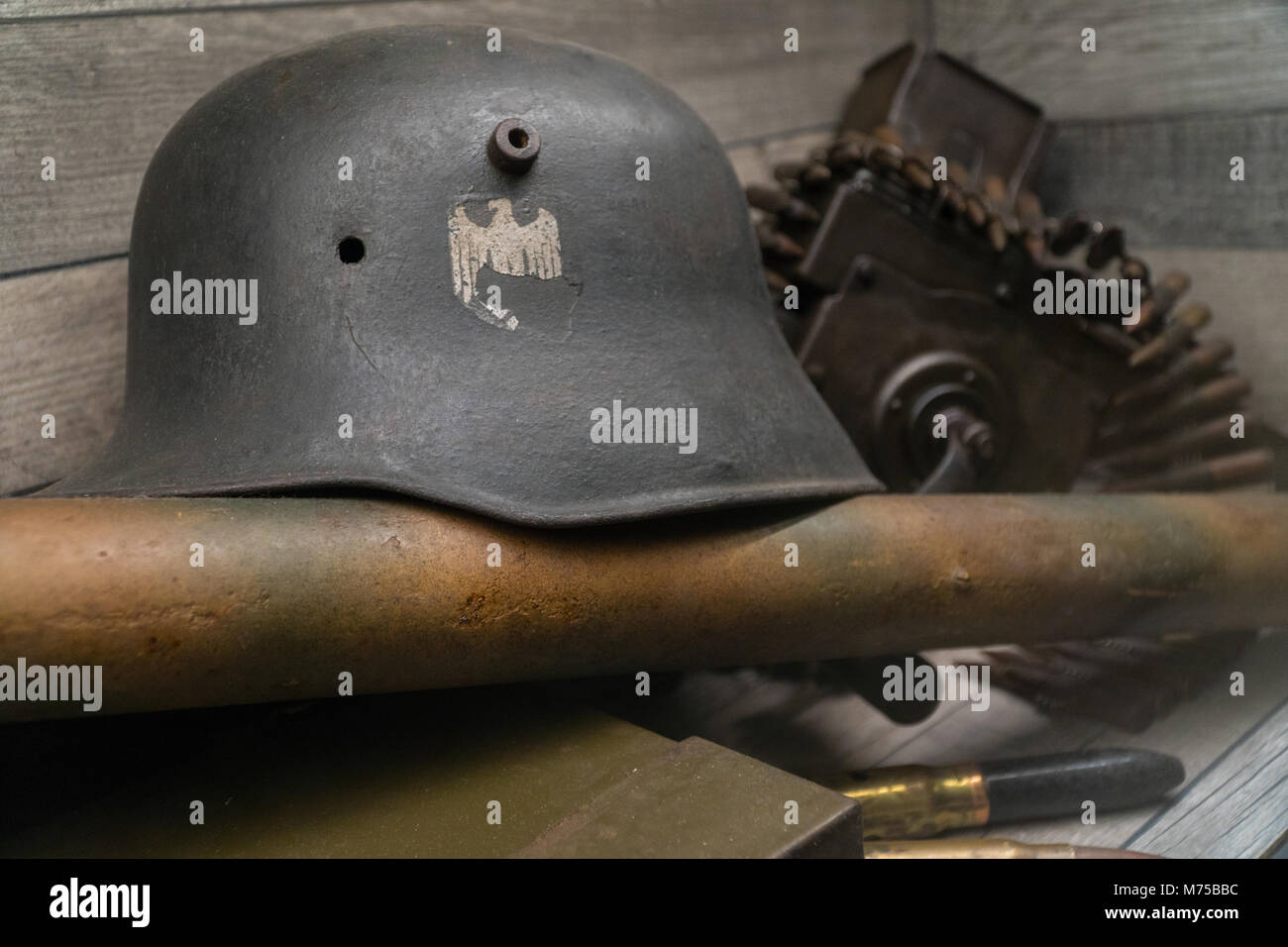 Old German military Third Reich helmet  on display at War Tunnells,Jersey,Channel Islands - Stock Image