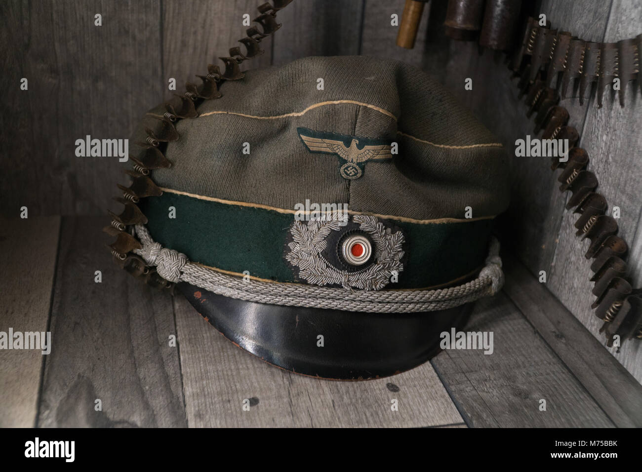 German military Third Reich cap on display at War Tunnells,Jersey,Channel Islands - Stock Image