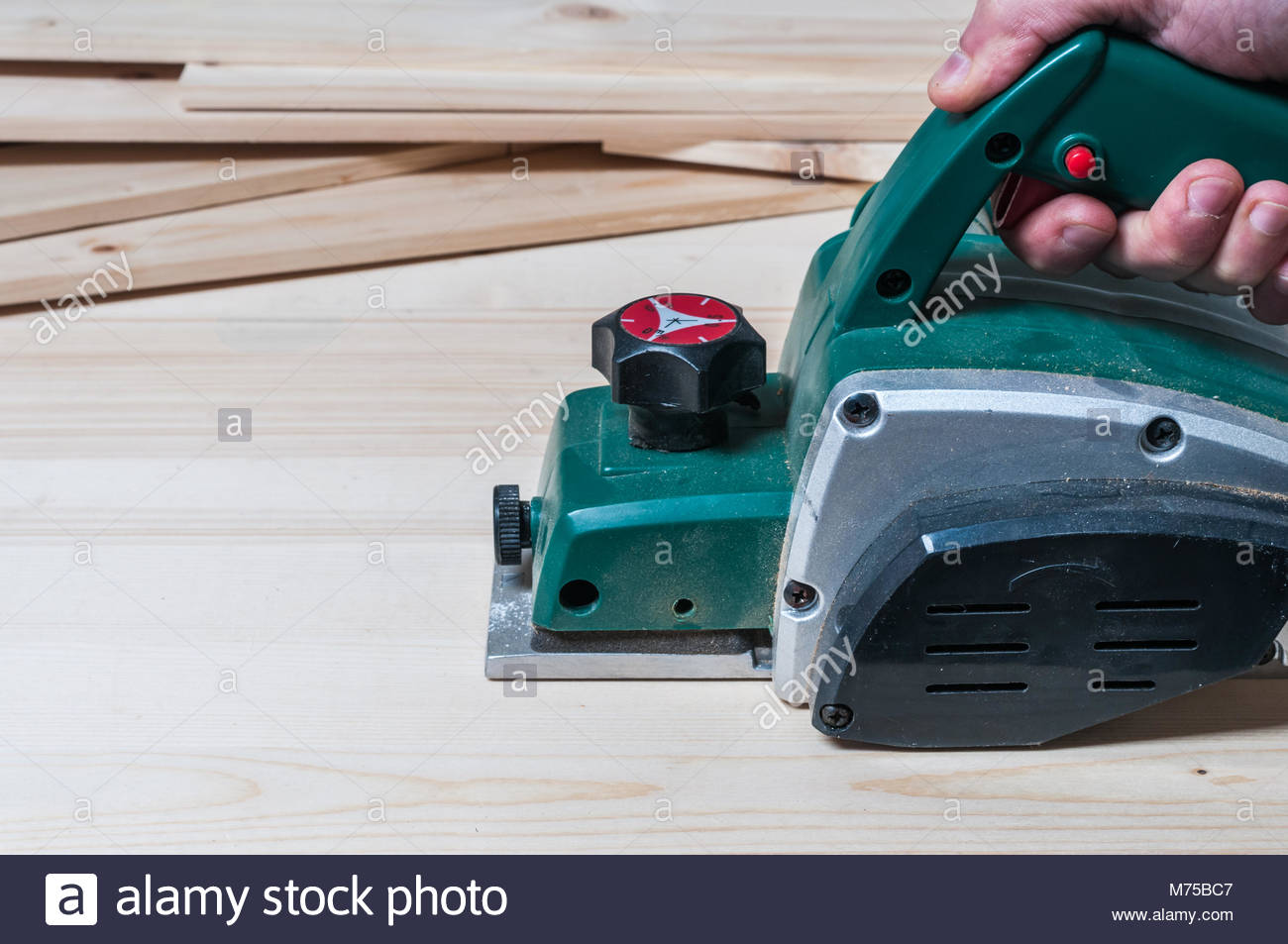 Electric Planer Stock Photos Images Alamy What Does An Do Carpenter Planing A Wood Surface With Tool Horizontal Composition