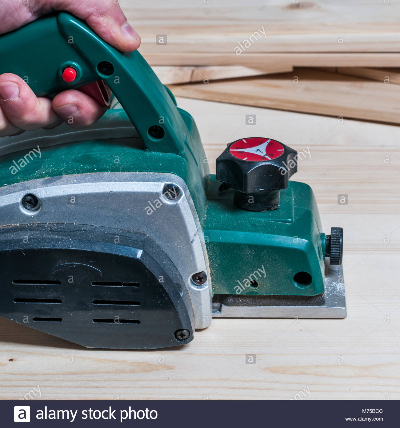 Electric Planer Stock Photos Images Alamy What Does An Do Carpenter Planing A Wood Surface With Tool Square Composition