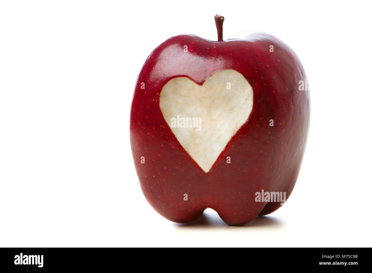 Apple with a heart. - Stock Image