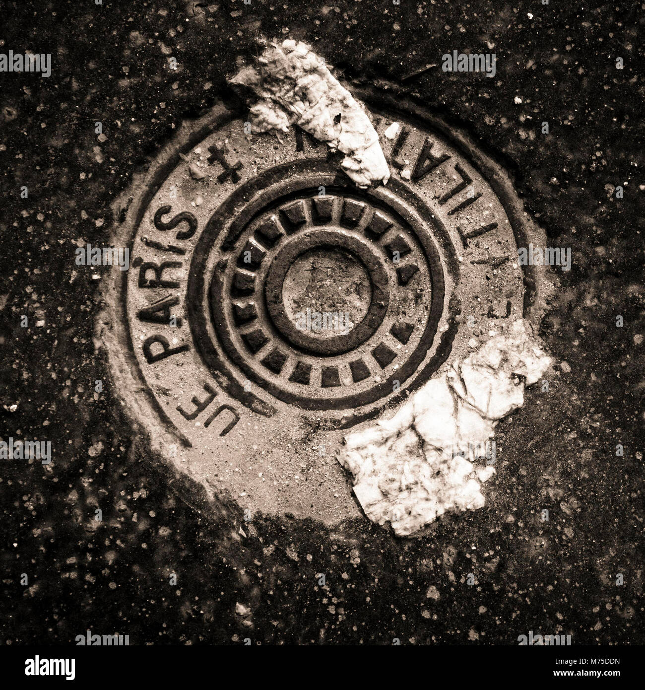 Sewer manhole. Paris. Ile de France. France - Stock Image