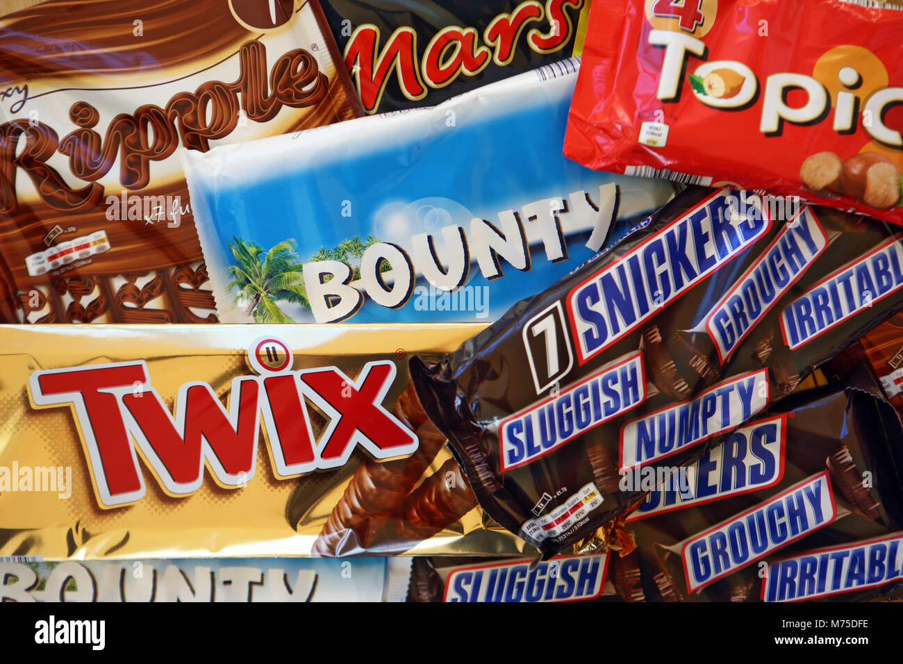 Multipacks of chocolate bars made by Mars, Incorporated including Bounty, Ripple, Twix, Mars, Topic & Snickers - Stock Image