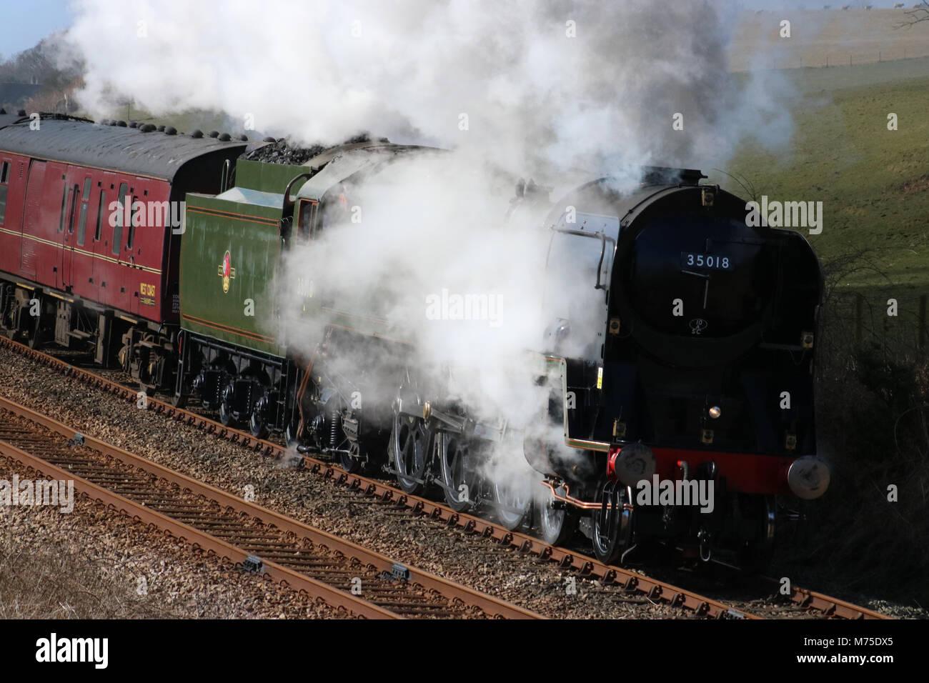 Steam train 35018 British india Line on a test run from Carnforth near Starricks Farm, Borwick. - Stock Image