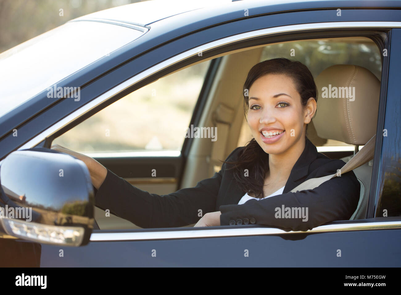 Business woman talking on her mobile phone. outside an office bussiness. - Stock Image