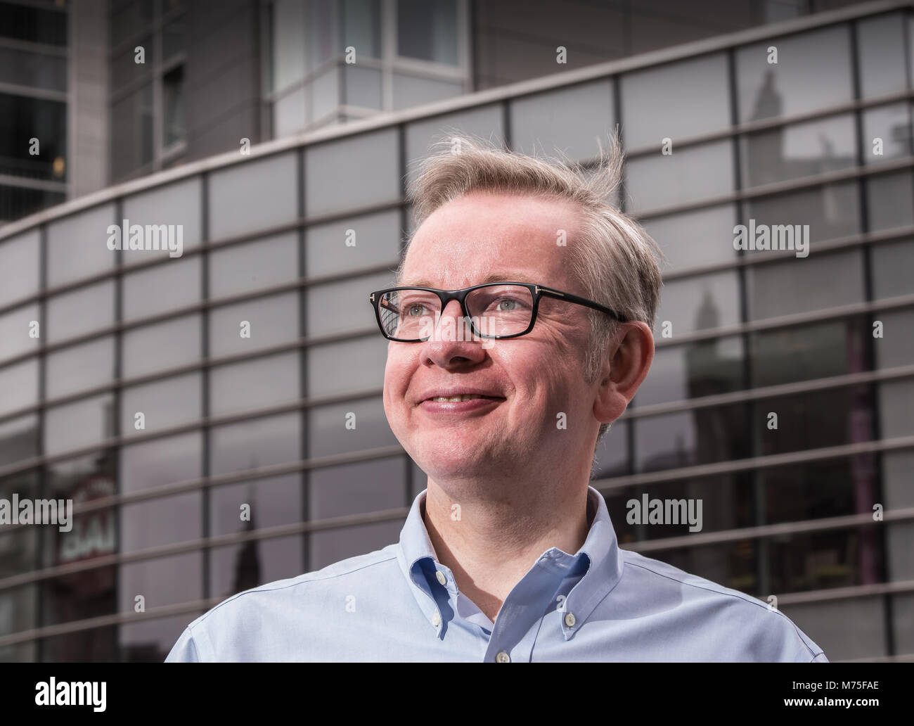 British Conservative Party Member of Parliament Michael Gove looking relaxed and wearing glasses - Stock Image