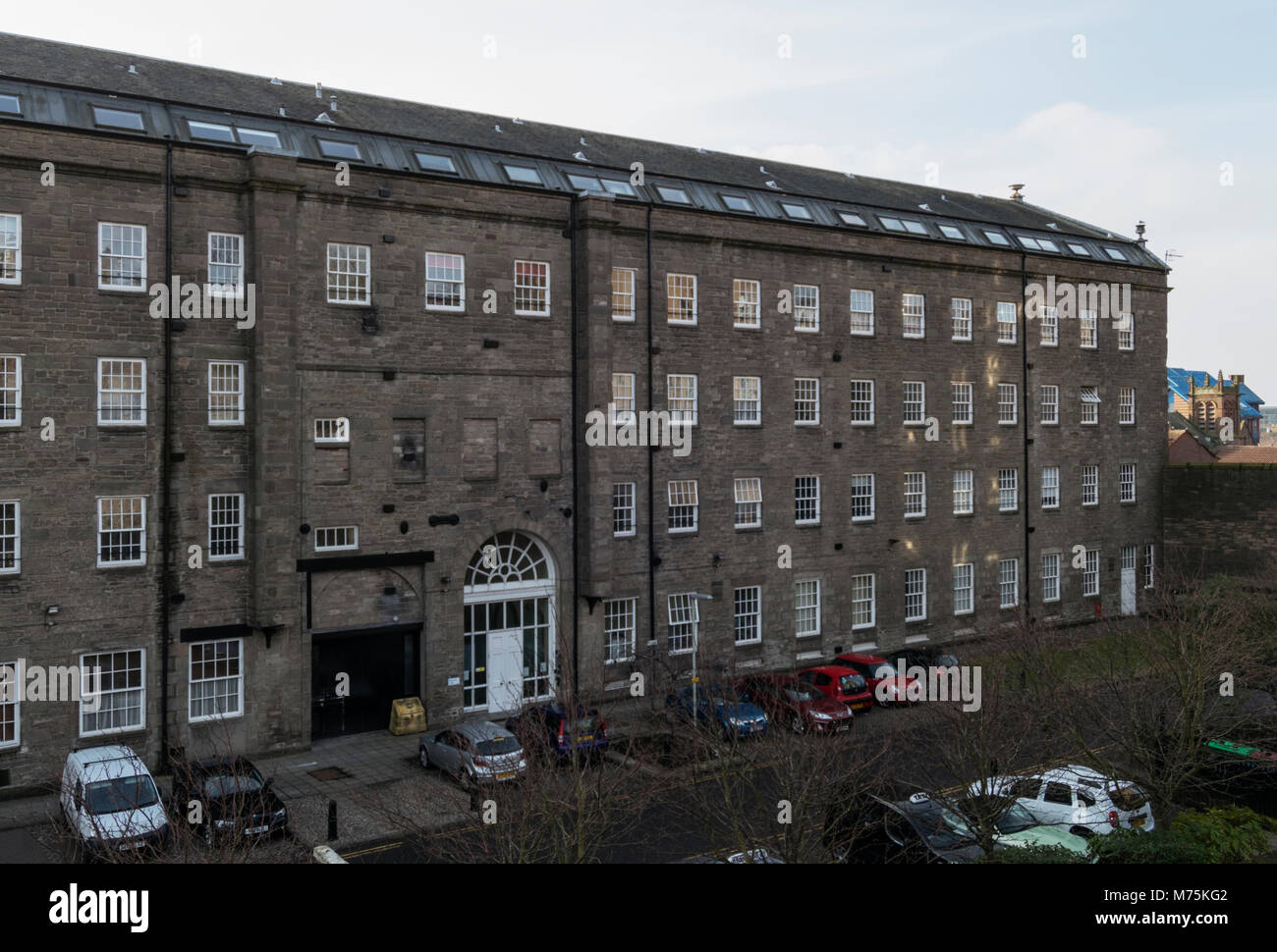 Once the largest textile mill in the world, Upper Dens Mill now provides modern housing in Dundee, Scotland, UK. - Stock Image