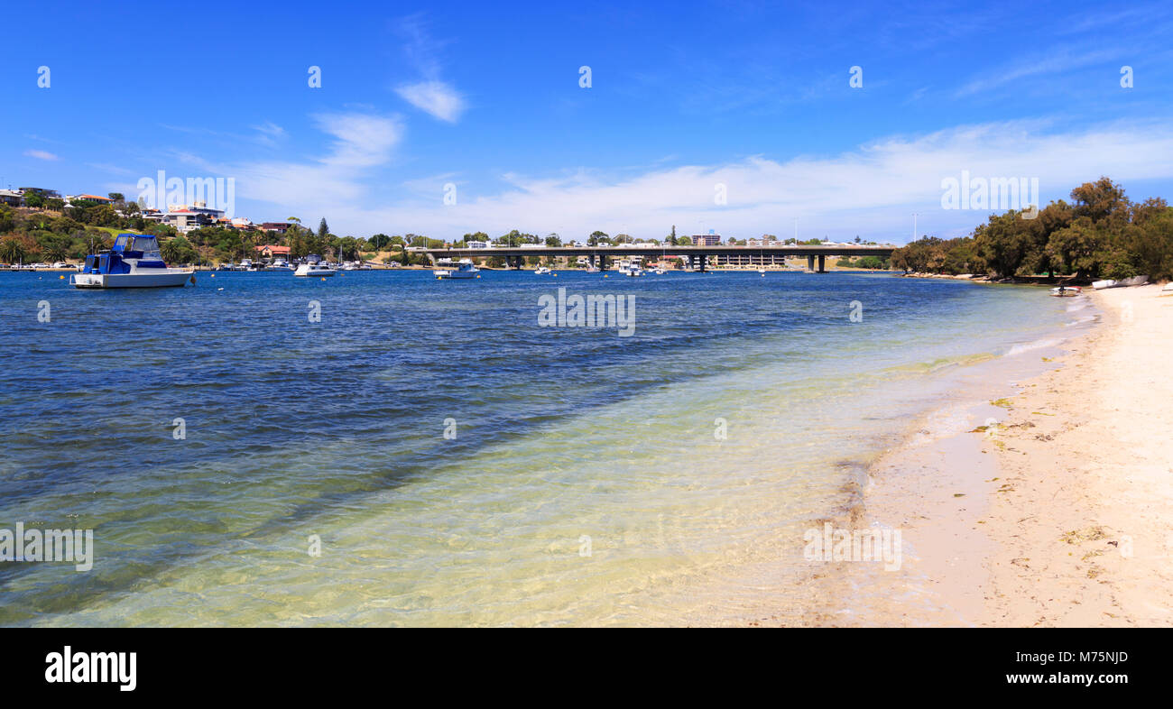 Beach beside the Swan River in North Fremantle with Stirling Bridge and East Fremantle in the distance. Western - Stock Image