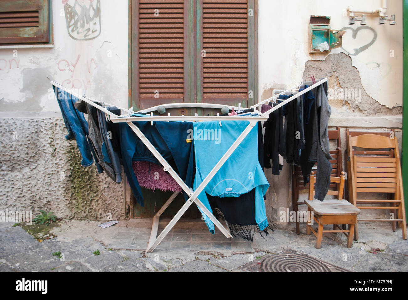Drying rack with cloths.  In the historic center of Naples it is customary to spread the clothes to dry in the air, - Stock Image