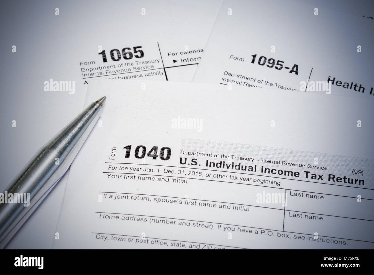 form 1065 and 1040  US tax form 8, 8, 8-A and pen Stock Photo ...