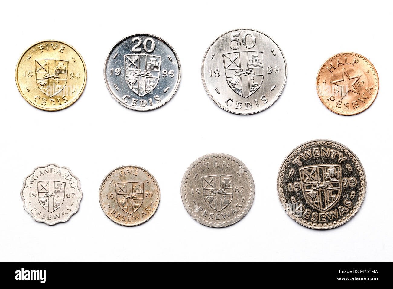 Ghanaian coins on a white background - Stock Image