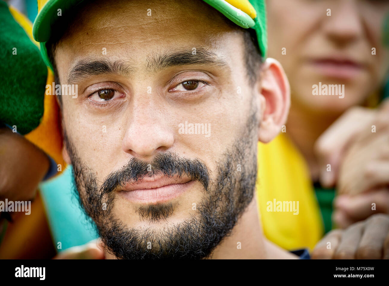 Football fan with tears in his eyes, portrait - Stock Image