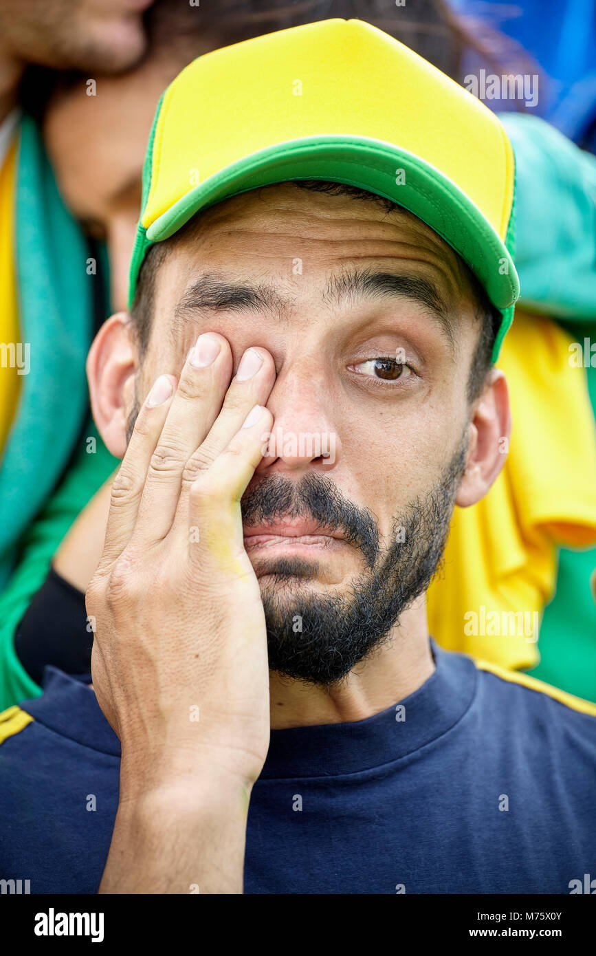 Football supporter crying at match - Stock Image