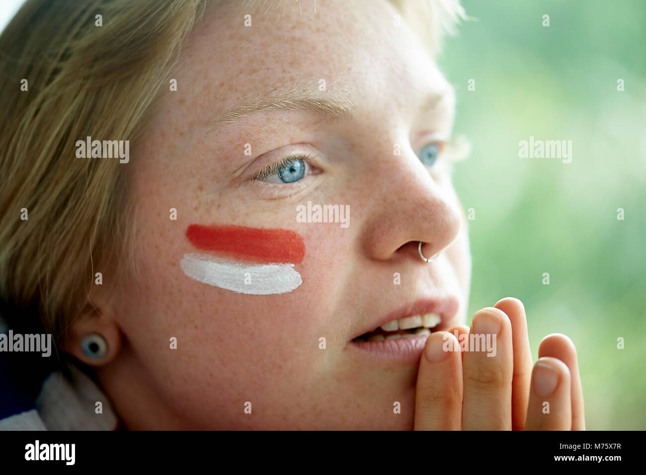 English soccer fan watching televised match - Stock Image