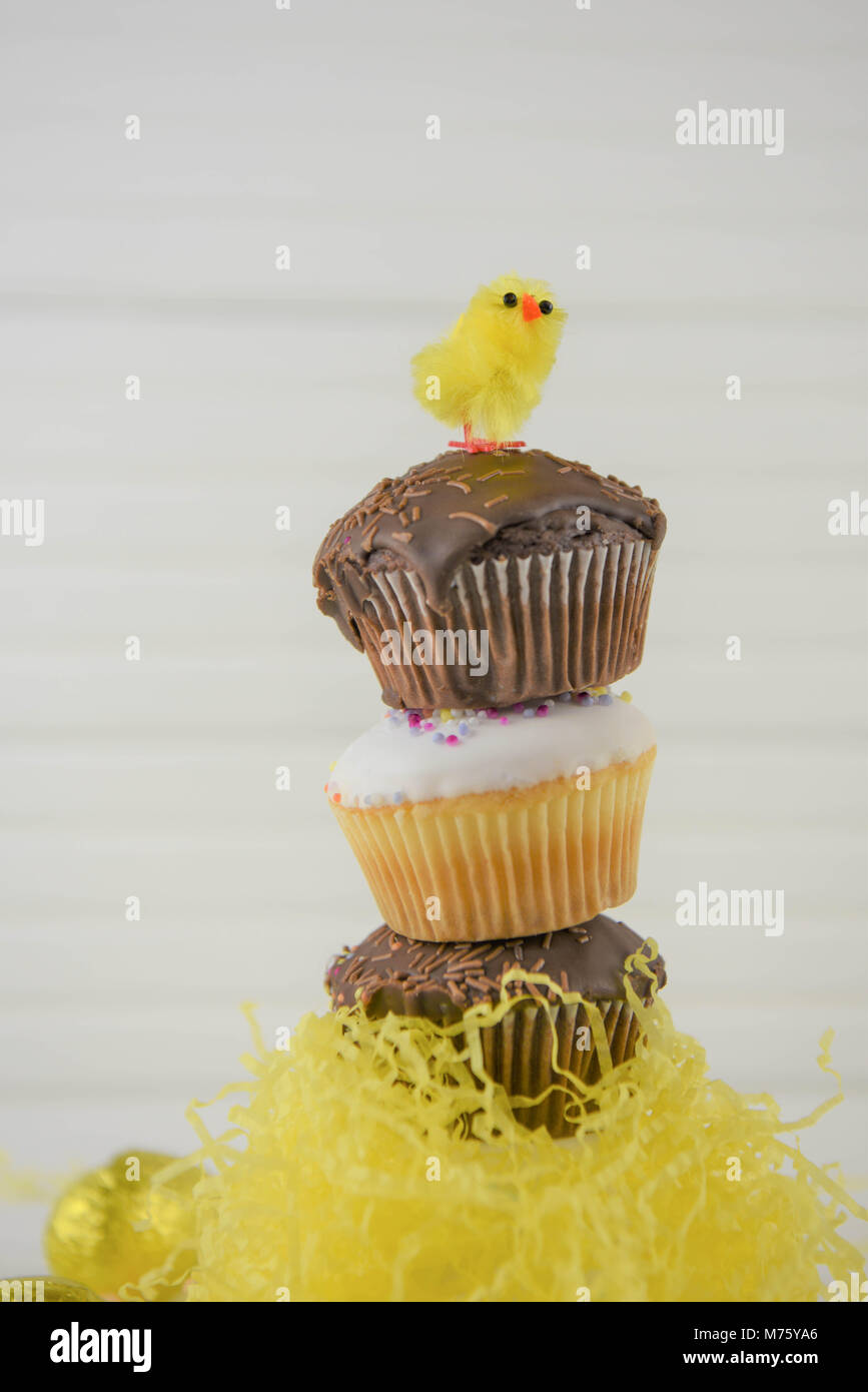 creative chocolate Easter cakes on white - Stock Image