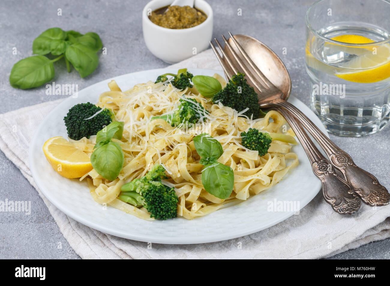 Homemade fresh pasta with pesto and broccoli with cheese and Basil. Tagliatelle. A delicious gourmet dinner. Selective - Stock Image