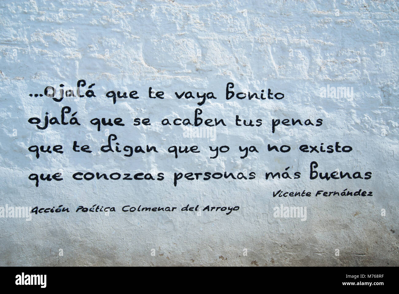 Poem written on a whitewashed wall. - Stock Image