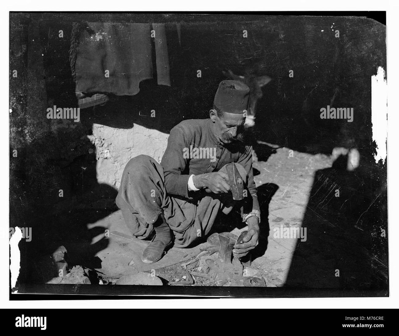 Native blacksmith making horseshoes LOC matpc.13021 - Stock Image