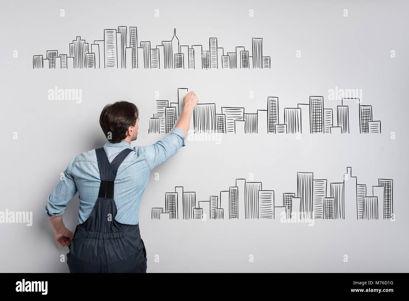 Creative engineer working at the drawing and feeling interested - Stock Image