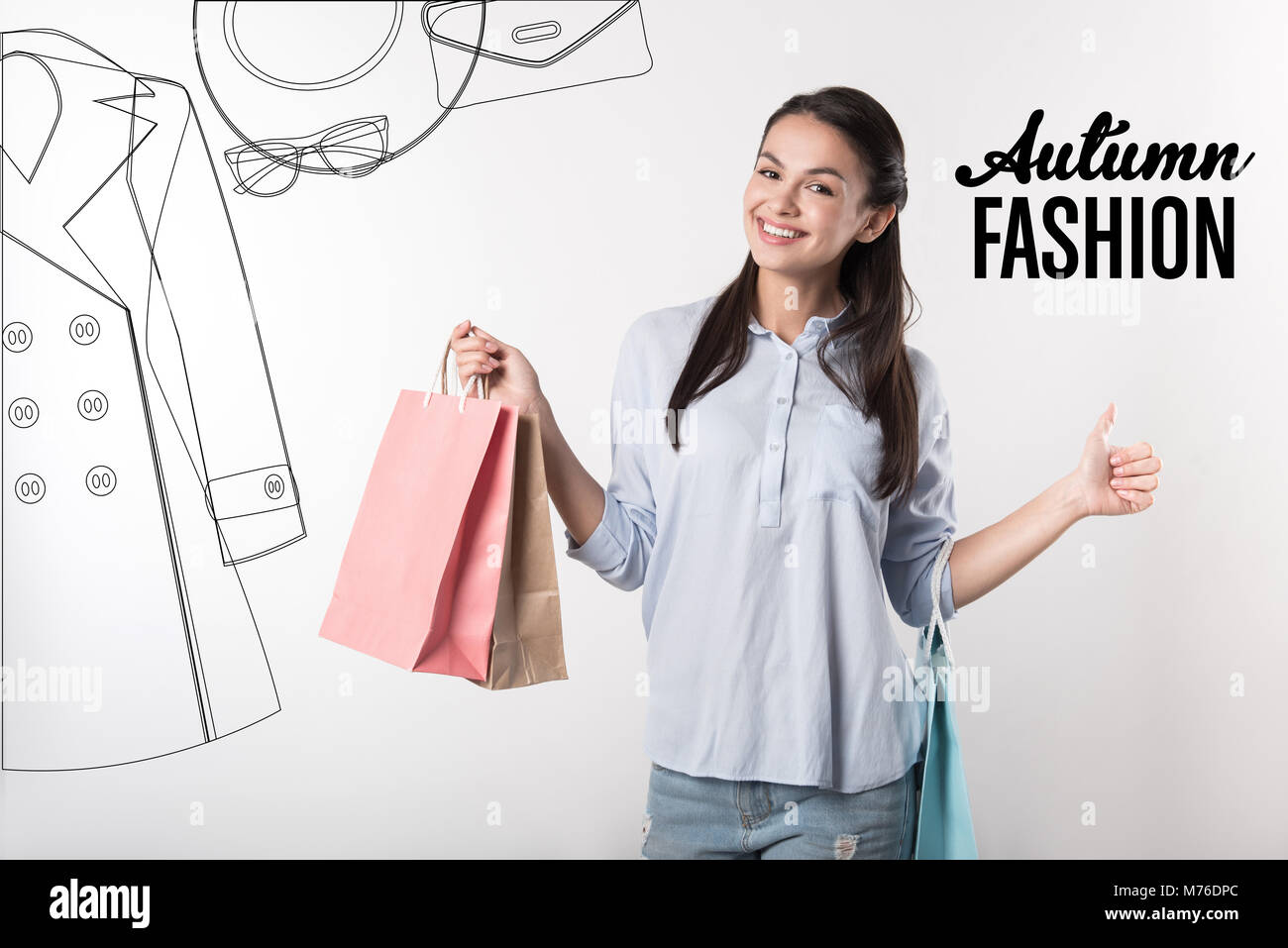 3c9a302ef4 Happy woman holding paper bags after buying new autumn clothes Stock ...