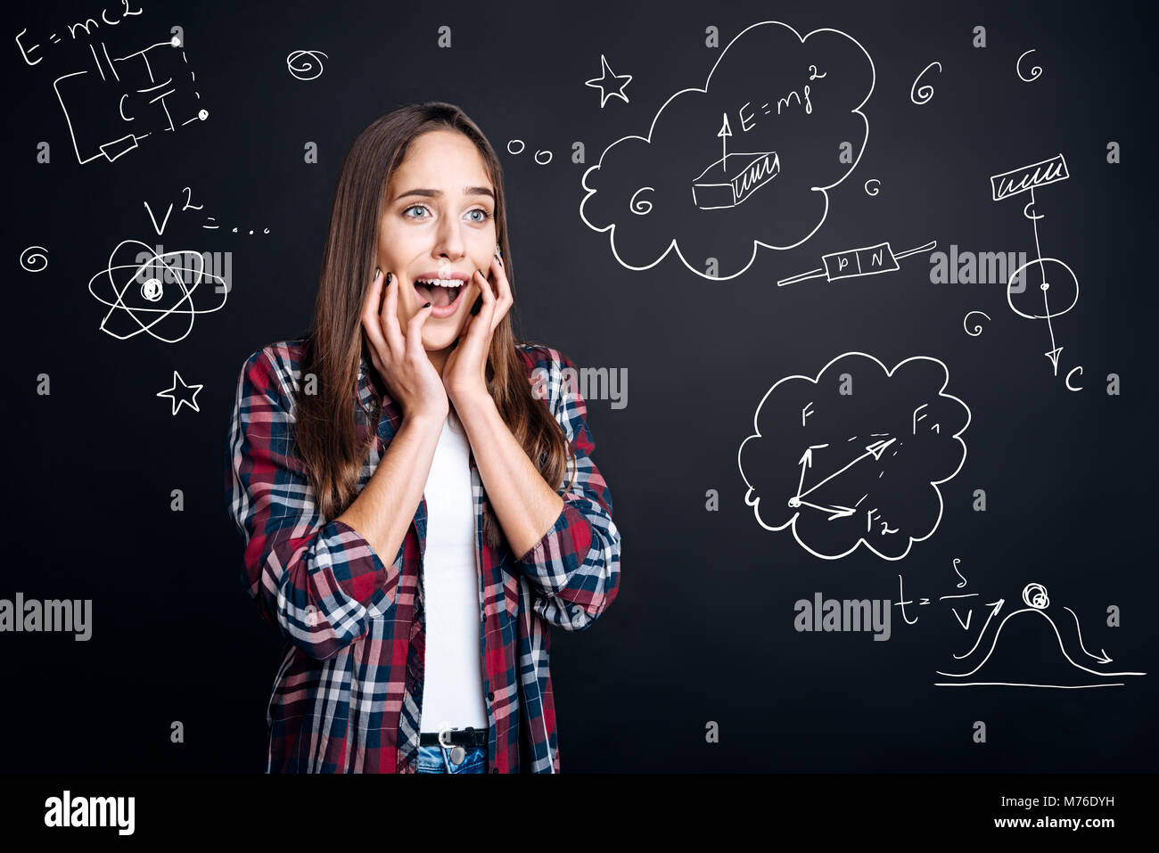 Emotional student feeling impressed while making a scientific experiment - Stock Image