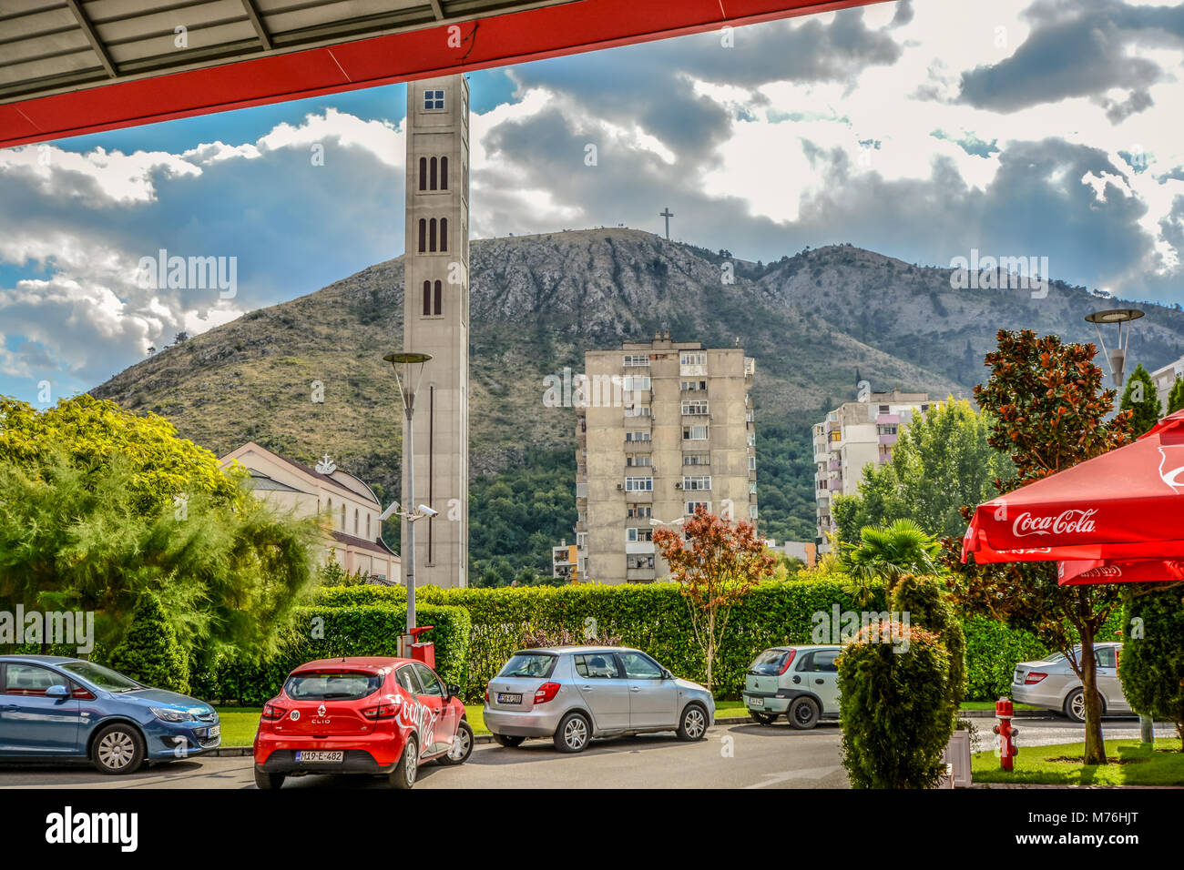 The cross over Mostar on Hum Hill stands atop the mountain overlooking Old Town Mostar, Bosnia Herzegovina - Stock Image