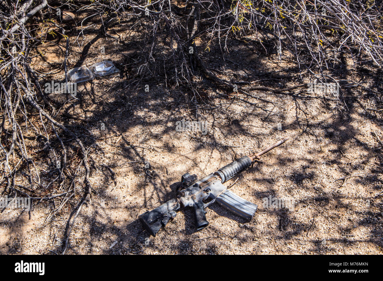 An AR 15 found in the desert. A smuggler's weapon. Stock Photo
