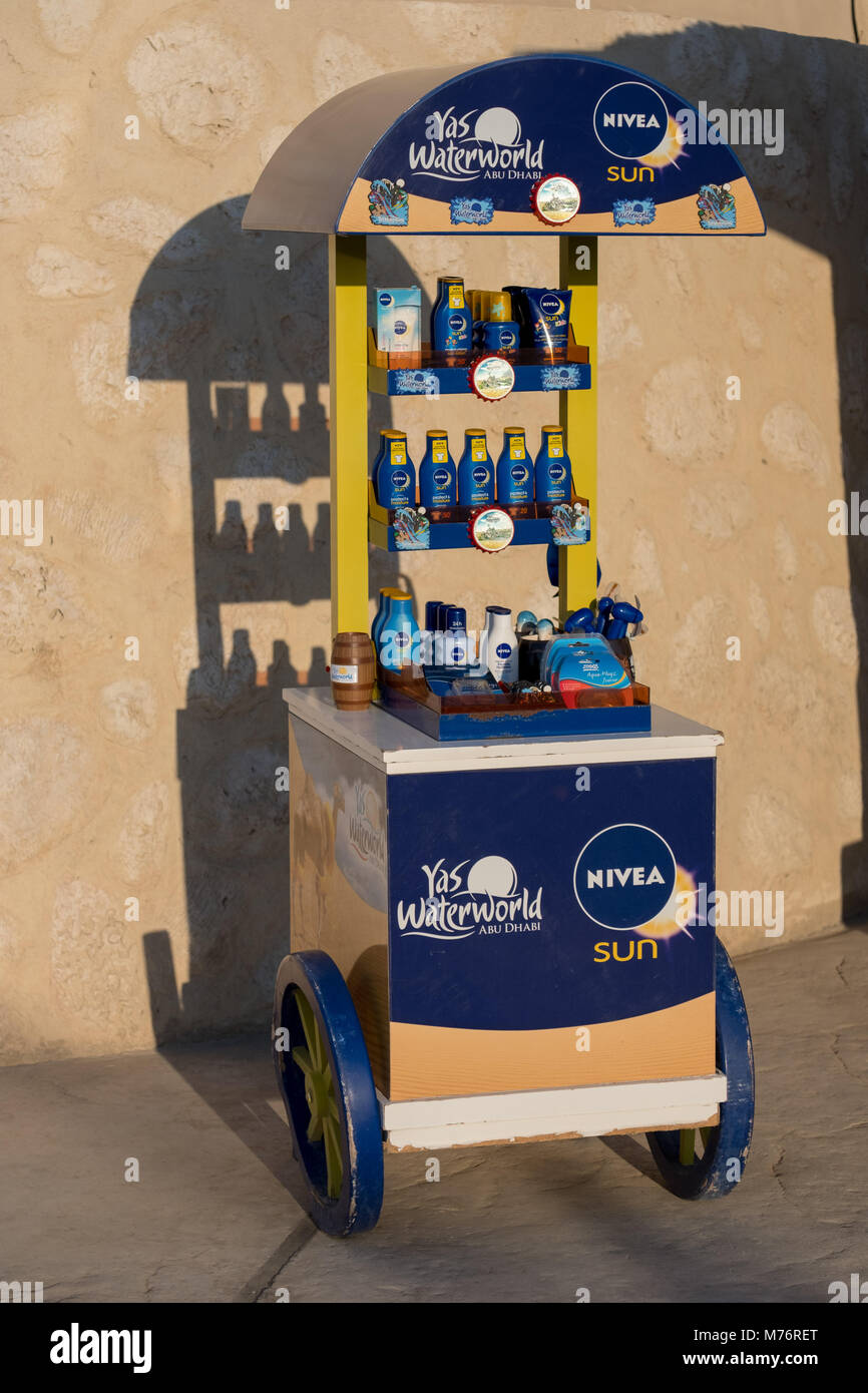 Nivea Point of sale Display Shop with wheels in front of Yas waterworld entrance. - Stock Image